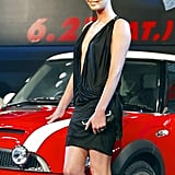 Charlize Theron wore a sexy black minidress as she posed with a Mini Cooper at the Tokyo premiere of The Italian Job in June 2003.