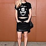 Dylan Penn was part party girl, part rebel in a skull tee and skirt by Coach.