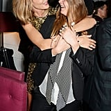 Meanwhile, Rosie Huntington-Whiteley scared the crap out of Cara Delevingne with her from-behind hug.