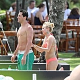 Hayden Panettiere lathered her boyfriend, New York Jets wide receiver, Scotty McKnight, with sunscreen in a bikini while vacationing in Hawaii.