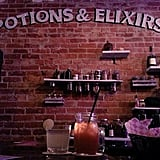 """""""Potions & elixirs"""" is painted on a brick wall — but do they have amortentia?"""