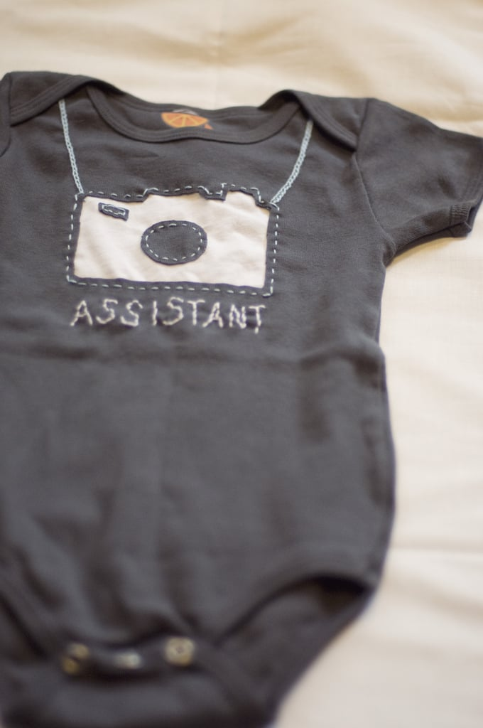 Amy Tangerine Photographer's Assistant Onesie ($39)