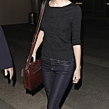 She Gave Off Retro Vibes With a Vintage-Looking Bag, Velvet Loafers, and Her Signature Red Lip