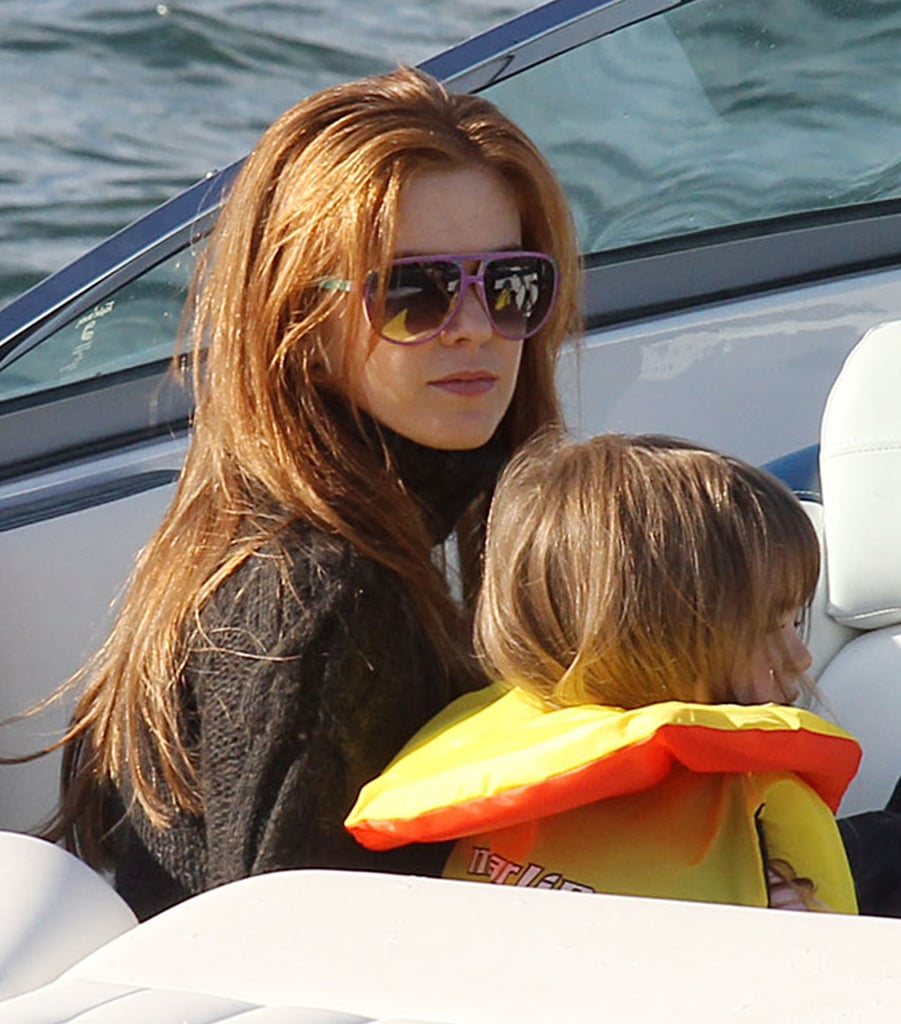 Isla Fisher and Olive Cohen on a boat together.