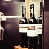 Sharing a bottle of red wine with friends.