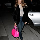 SJP is not afraid to rock neon colors as exemplified by her hot pink Louis Vuitton satchel, which she paired with a black collarless blazer, skinny jeans, and lace-up booties.       Skinny Denim at Revolve ClothingBoots by Chinese Laundry