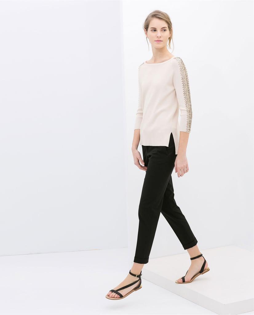 Zara cream sweater with rhinestones on the sleeves ($80)