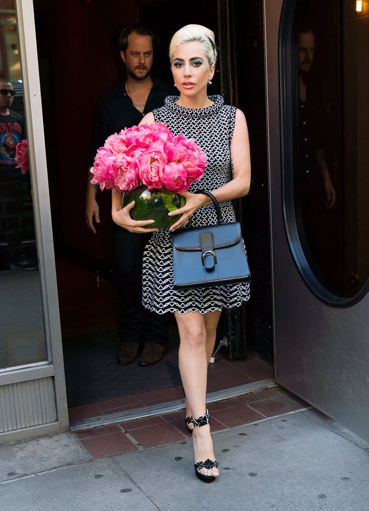 We love when she gives off vintage Hollywood vibes like she does with this outfit. She's holding a Delvaux handbag.