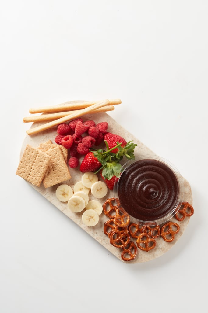 Whether you do or don't have a valentine this coming holiday, Sabra is really making a strong case for itself. Following the release of Trader Joe's popular chocolate hummus, the brand decided to give its own chickpea spread a sweet spin with a new Dark Chocolate Dessert Dip and Spread.  Hitting stores soon, the (vegan!) dip predominantly consists of chickpeas, cocoa, brown sugar, sea salt, and vanilla extract. Each container has about eight servings, with each serving of two tablespoons containing 80 calories. The decadent chocolate hummus pairs well with pretzels, graham crackers, crunchy breadsticks, fruit, or, simply, spoons. See pictures of the unexpected treat ahead.      Related:                                                                                                           Treat the Loaf of Your Life to Olive Garden's Breadstick Bouquets This Valentine's Day!