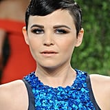 Her cobalt blue and brown eye makeup paired with her slick hair created a modern look that complemented her glittering gown at the 2013 Vanity Fair Oscar party.