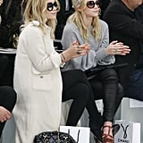 Twinning combo: The girls took in the Chanel Fall/Winter 2008 show with killer eyewear.  Ashley paired a long, white tweed coat with black ankle boots, a quilted bag, and oversize shades. Mary-Kate went sporty in a grey sweater, black leather leggings, and YSL platforms and a printed headscarf.