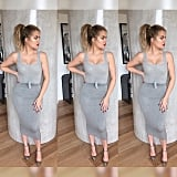 Khloé in a sexy, curve-hugging, all-gray look of the day.