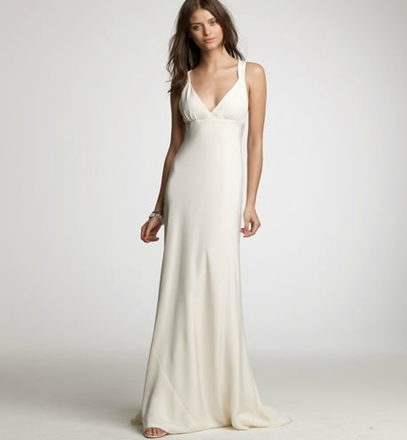 This gown has an easy elegance that would work just as well at an evening ceremony as it would at a more casual day setting with more low-key accessories.