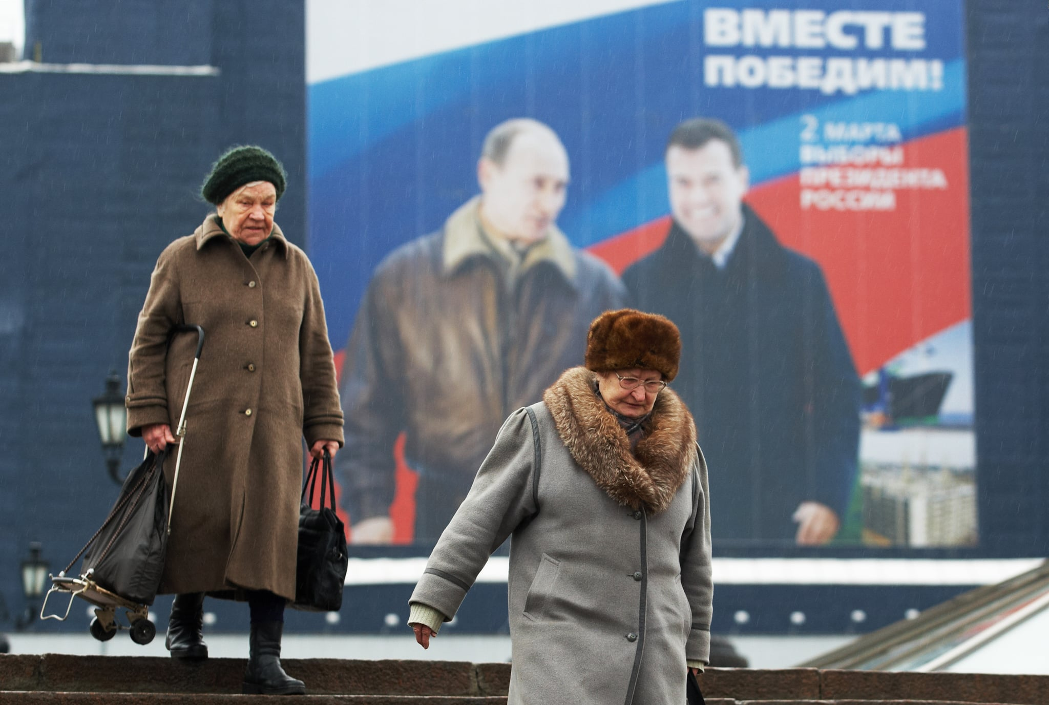 """Putin with likely successor Dmitry Medvedev. Poster says """"Together we will win!"""""""