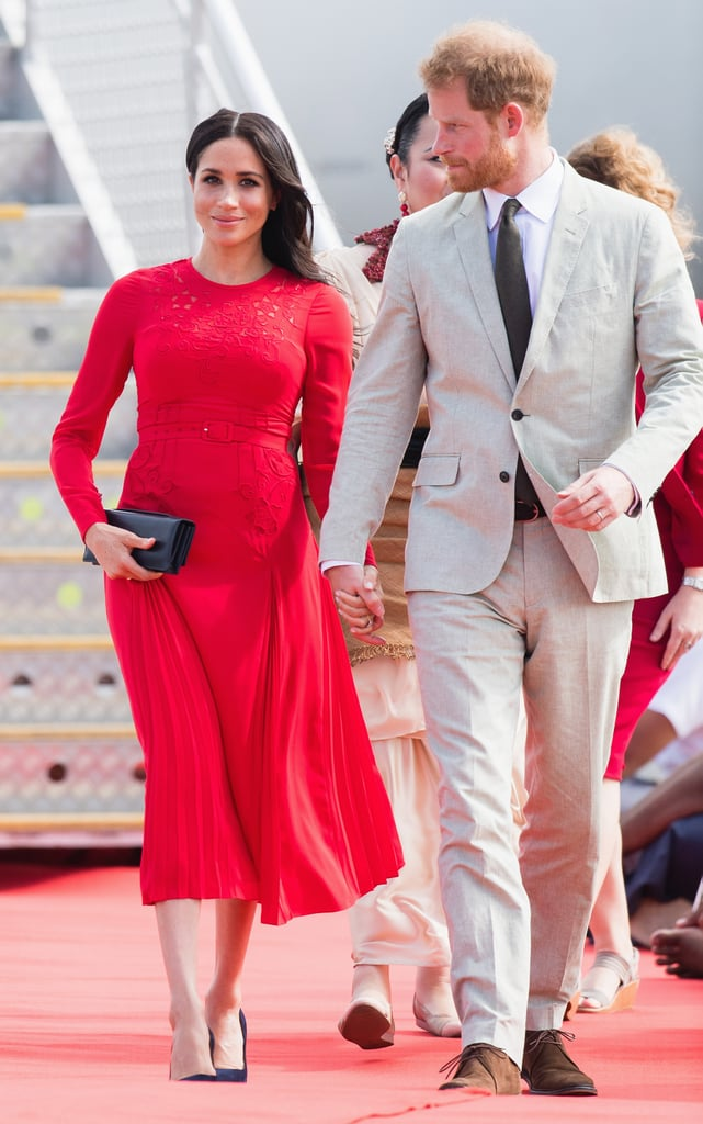 Meghan showed off her growing baby bump during the 2018 tour in this bright red Self-Portrait number when she touched down in Tonga with Prince Harry.