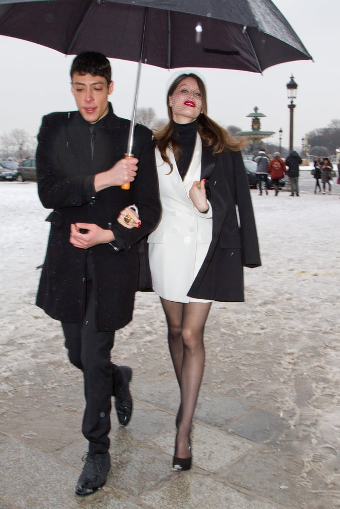 Laetitia Casta chose a black and white color scheme — perfection for Paris. Her netted veil and bold red lips added major glamour to her two-tone style.