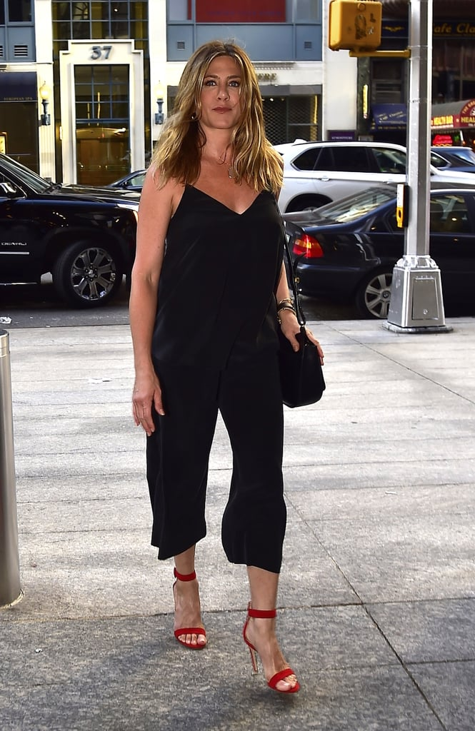 Opting For a Black Jumpsuit With a Plunging Neckline