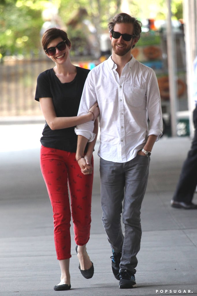 Anne Hathaway took a romantic stroll with her husband, Adam Shulman, in NYC yesterday during downtime from filming her newest project, Song One. Anne is filming Song One in the Big Apple while also doing voice work for Rio 2, the sequel to her animated hit Rio. Aside from her film work, the couple have been taking it easy after Anne's big Oscar win earlier this year. However, that doesn't mean that Anne hasn't been making headlines since then. Anne was the talk of the town when she popped up with a bleached blond 'do at the 2013 Met Gala in May. She went back to brunette by the end of that month.