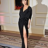 Victoria showing a slip of leg in a maxi at the British Fashion Awards in 2010.