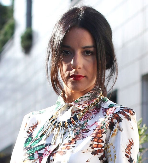 Her statement necklace lent tons of sparkle to a boho maxi. Source: Greg Kessler