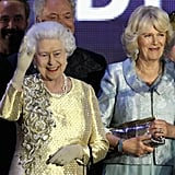 The queen waved to the crowds at the Diamond Jubilee Concert at Buckingham Palace.