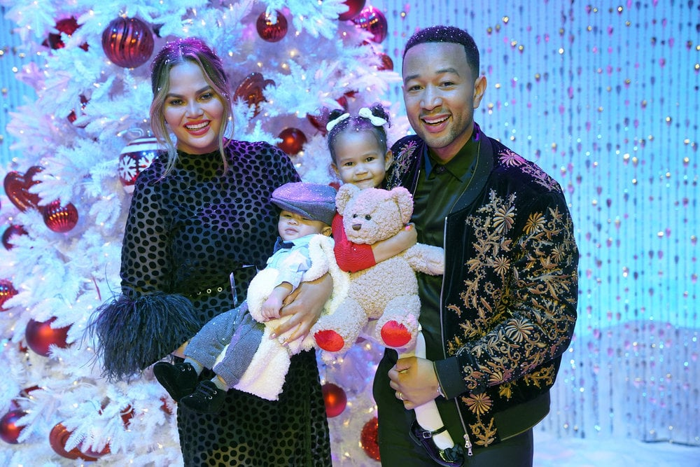 """Everyone's favourite couple Chrissy Teigen and John Legend invited fans into their home for NBC's A Legendary Christmas, and it was exactly that and so much more. With 2-year-old Luna and 6-month-old Miles in tow, Chrissy and John's TV special was bound to be an """"aww""""-inducing night, but nothing could've prepared us for the hilarity and sweet glimpses we'd get of the family. Just when we thought we couldn't be more obsessed with them, enter: Chrissy and John's mac and cheese competition, aka the """"S'Macdown."""" They went caroling with stars like Meghan Trainor and Darren Criss, and Chrissy even had a nightmare landing her on The Voice with the toughest judge the show has seen yet: her husband.  Joining the family was Kim Kardashian, Kris Jenner (the """"fairy godmomager""""), Stevie Wonder, Awkwafina, the Queer Eye Fab 5, and so many more celebrities. Read on to see all the photos from A Legendary Christmas, and prepare to wish you were a Legend more than ever before. Although the special has already aired in the US, it will be screening in Australia on Channel Nine on December 21. We know we're counting down the days!"""