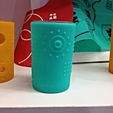 Silikids places silicone covers over drinking glasses to introduce real glasses to tots.
