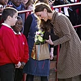 Kate Middleton talked to a pair of cute schoolboys as she arrived for a visit to England's Rose Hill Primary School in February 2012.