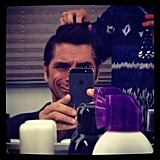 John Stamos took a photo while getting his hair done on the set of Necessary Roughness. Source: Instagram user johnstamos