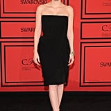 Jessica Chastain managed to make a simple black strapless Givenchy by Riccardo Tisci Resort 2014 dress look superbly sexy. She finished with Givenchy ankle-strap sandals and an Irene Neuwirth cuff.