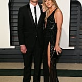 For the 2017 Vanity Fair Oscars party, Jennifer showed up in a slinky Versace dress while Justin went with a classic tux.