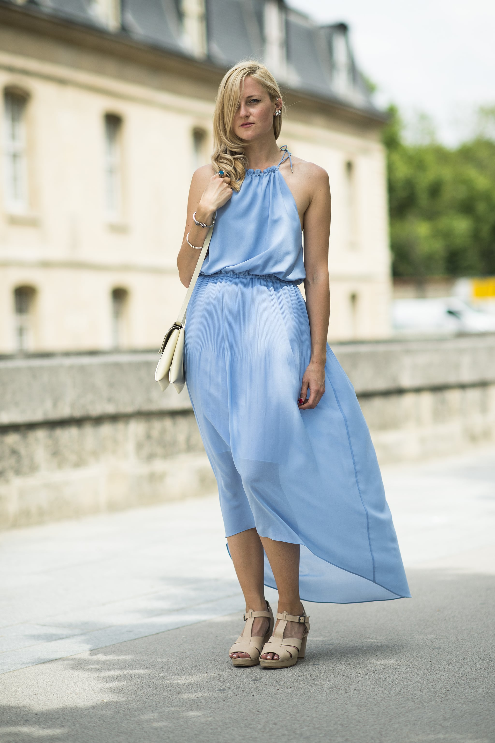 As breezy as it is chic, this showgoer turned heads with a perfect baby-blue halter dress. Source: Le 21ème | Adam Katz Sinding