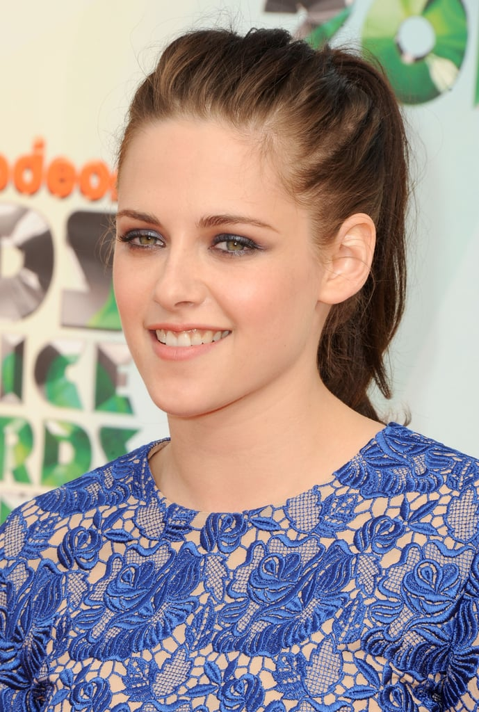 Kristen Stewart kept the attention on her lace dress by foregoing any major jewelry.