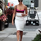 Jessica Alba held on to her phone while leaving her SoHo hotel in NYC.