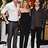 Liam Hemsworth, Jennifer Lawrence, and Sam Claflin attended a photocall for Catching Fire at the Majestic hotel.