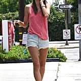 Alessandra stuck to her denim cutoffs, a star-print tank, and mirrored sunglasses in LA.
