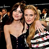 Pictured: Dakota Johnson and Riley Keough