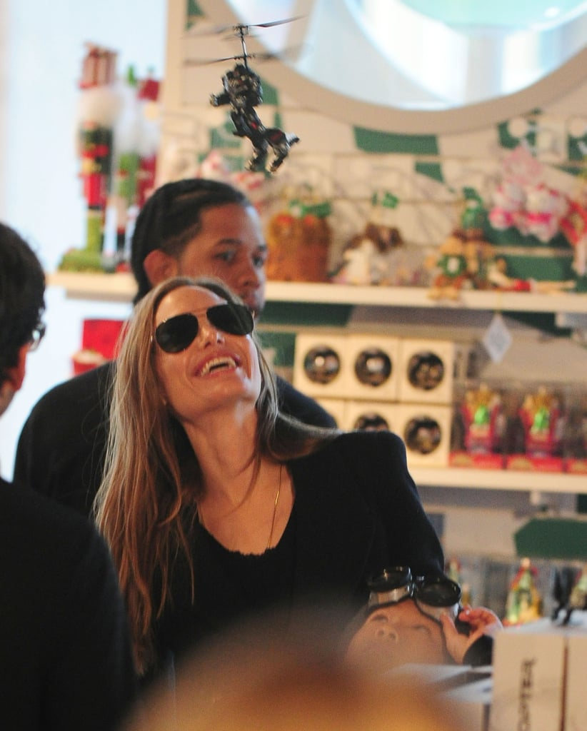 Angelina Jolie laughed during a shopping trip in NYC.