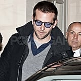 Bradley Cooper wearing blue glasses.