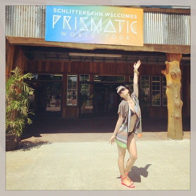 Katy Perry raised a hand in front of a sign for her tour.  Source: Instagram user katyperry