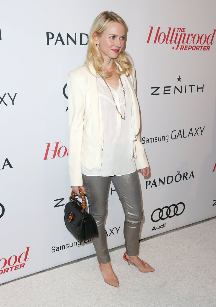 Naomi Watts carried a black purse.