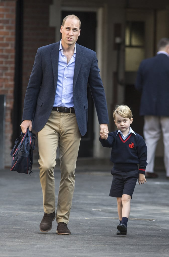 Prince George attended his first day of school today, arriving bright and early at Thomas's Battersea School in London. His mother, the Duchess of Cambridge, was unfortunately unable to be there for this special moment, as she is expecting her third child, and once again suffering from hyperemesis gravidarum. Luckily, George was in very capable hands as he arrived at the school gates holding hands with his dad, Prince William. Here he was greeted by Helen Haslem, Head of the lower school, who shook the young royal's hand before escorting him and his dad into the building. George looked a little nervous as he approached the school, giving us a glimpse of that now-famous unimpressed face as he walked past photographers, showing off his smart school uniform. Keep reading to see more photos of George's big day.