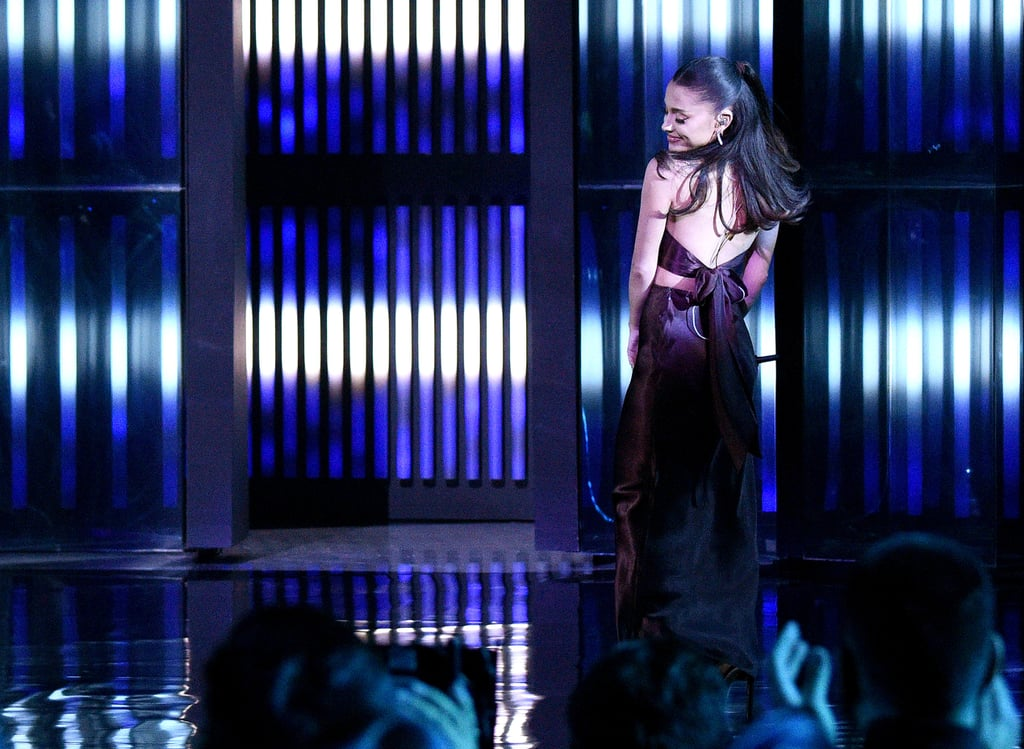 """Ariana Grande is still basking in bridal bliss, as evidenced in part by her latest award show beauty look. The day after sharing photos from her intimate wedding to Dalton Gomez earlier in the month, the singer appeared at the 2021 iHeartRadio Music Awards to perform her remix of """"Save Your Tears"""" with The Weeknd. In a sweet twist, Grande appeared to recreate the same hairstyle she wore at her wedding.  Despite popular theories that she would wear her signature ponytail on her wedding day, Grande and hairstylist Josh Liu actually went with a half-up hairstyle with bouncy curls at the bottom. Not only was her hair the same at Thursday's award show, but she also kept around her """"deep"""" french manicure. Why fix what's not broken, right?      Related:                                                                                                           Ariana Grande Knew Who Would Be Making Her Custom Wedding Dress Since 2018"""