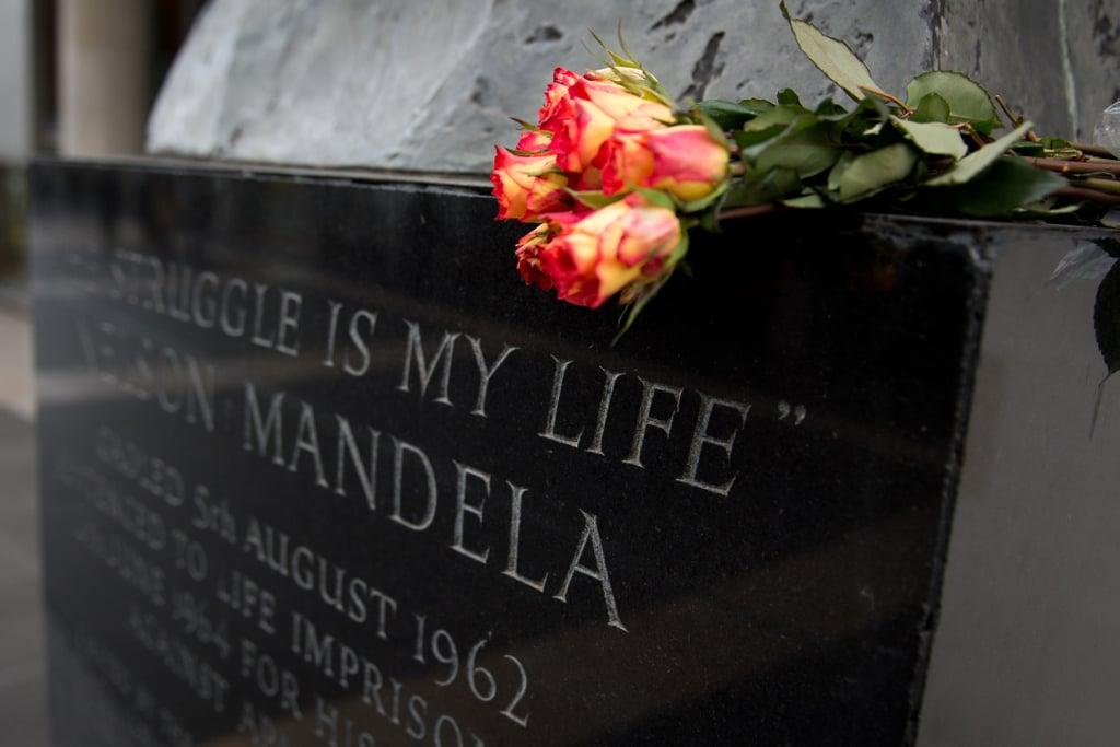 Flowers were set on a Nelson Mandela statue in London.