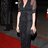 Sweet and sophisticated in a sheer front-ruffle sheath and strappy sandals for the LA premiere of Friends With Money in 2006.