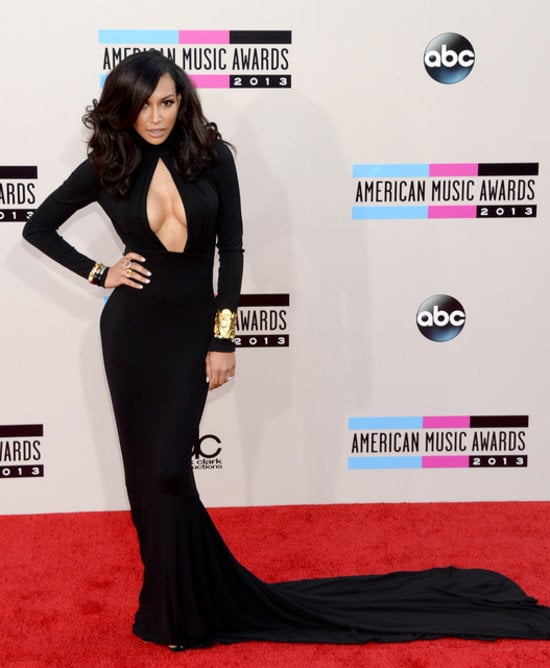 If Naya Rivera was your barometer of the American Music Awards, the temperature would've been positively sizzling. With a high neck and long sleeves, her black dress could've been conservative, but . . . no way! A large keyhole showed some serious cleavage that ensured the overall look was way sexy. Instead of lots of bling, she went with gold at the wrists.