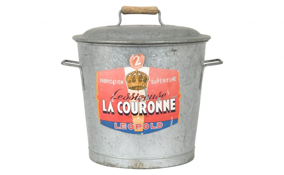 Come baring this vintage metal bucket with lid ($150) to keep a bottle of bubbly chilled.