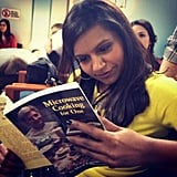 """Mindy Kaling leafed through the """"world's saddest and funniest prop"""" on the set of The Mindy Project. Source: Twitter user mindykaling"""
