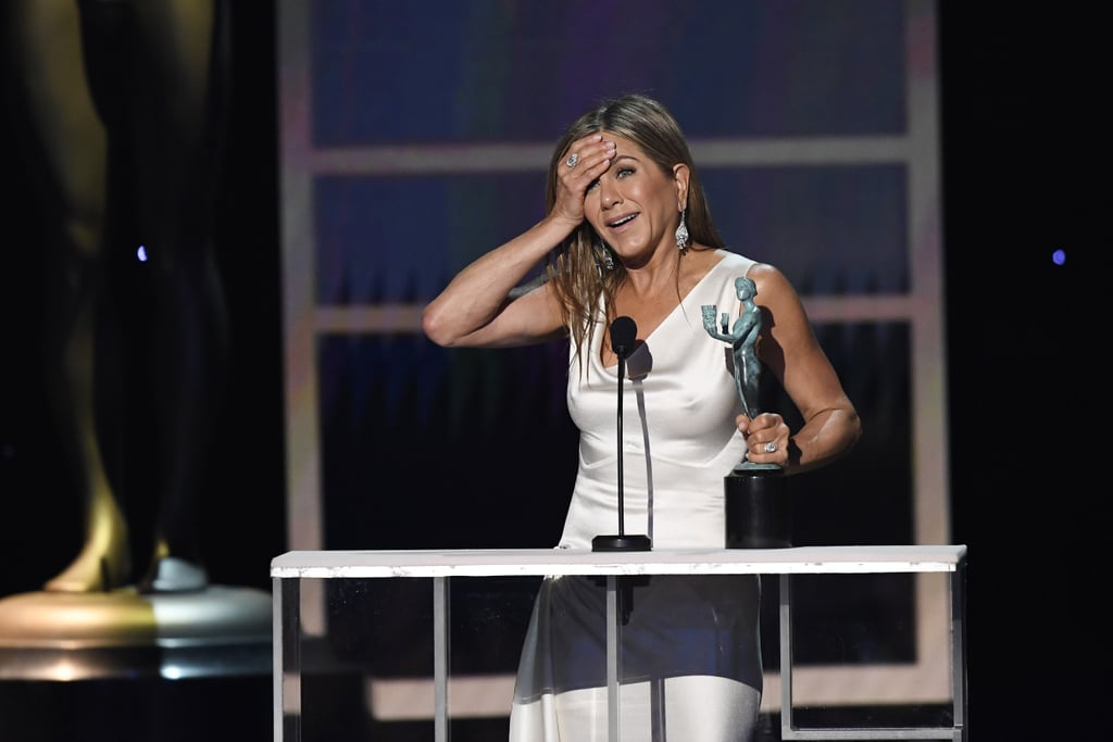 Jennifer Aniston was her usual lovable self as she won outstanding performance by a female actor in a drama series at the SAG Awards on Sunday. After taking home the special honor, the Morning Show actress looked adorably flustered as she made her way to the stage. Not only was the award one of the first big wins for the Apple TV+ series this award season, but it also marked Aniston's first SAG win in over two decades. She previously took home outstanding performance by an ensemble in a comedy series in 1996 for Friends. In addition to getting support from her costar Reese Witherspoon in the audience, Aniston's ex Brad Pitt was spotted proudly watching her speech backstage. See more photos of Aniston's win ahead.       Related:                                                                                                           Jennifer and Brad's Backstage PDA Means Something, I Just Don't Know What
