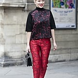 Lacy trousers and a printed blouse paired up for a bold head-to-toe style.
